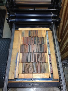 Bed of the press with test forme of 20-line lightly used wood type.